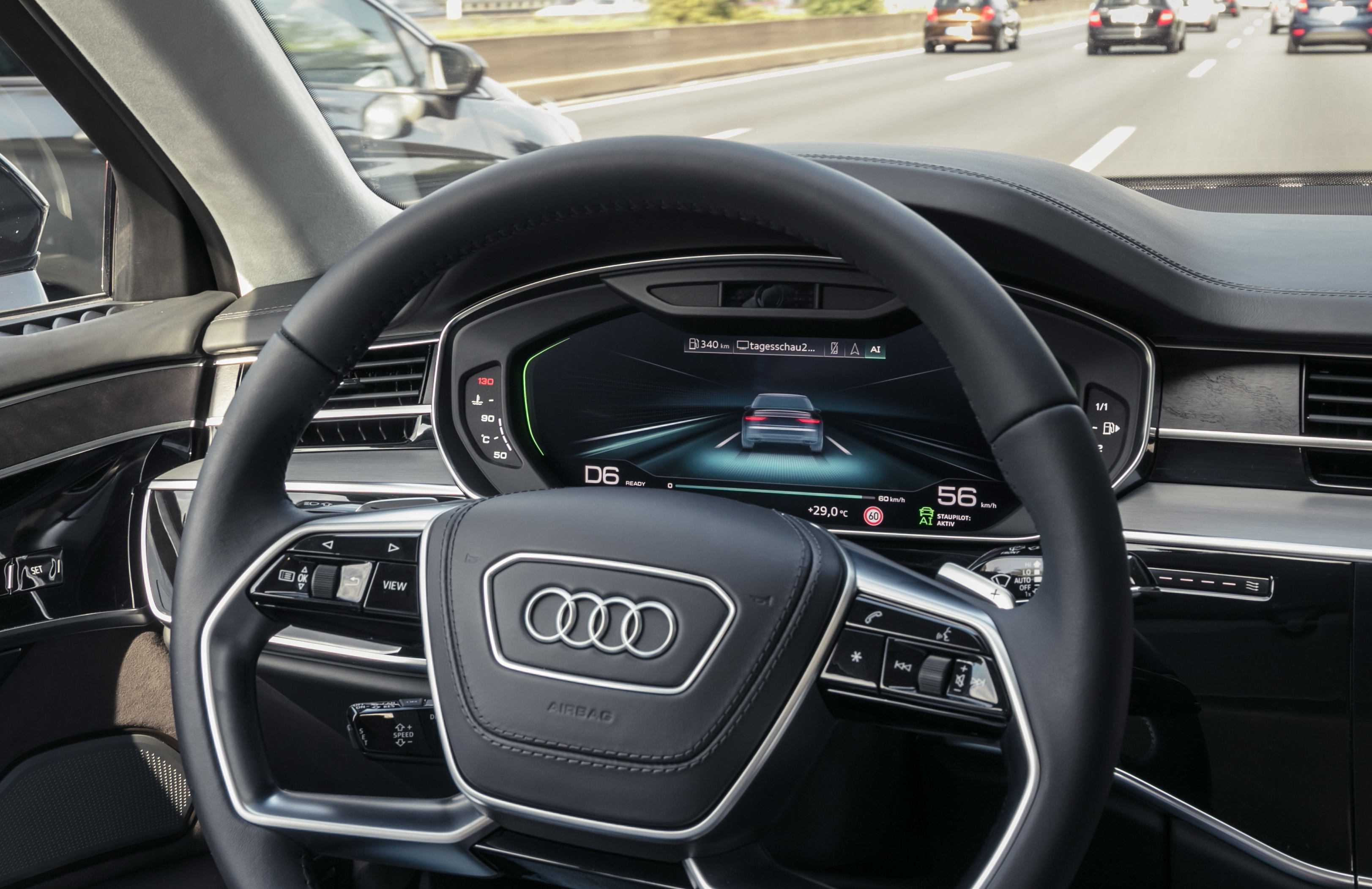 Audi A8 driving automatically in a traffic jam, seen from interior perspective